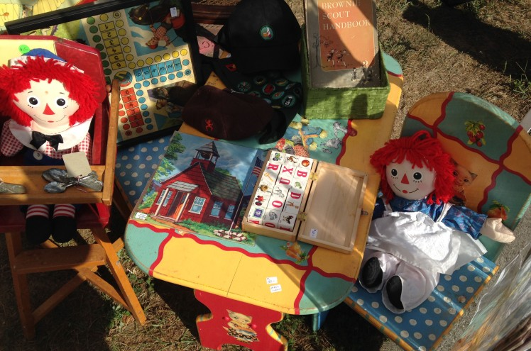 old friends, Raggedy Ann and Andy, sitting on a hand-painted play table with chairs