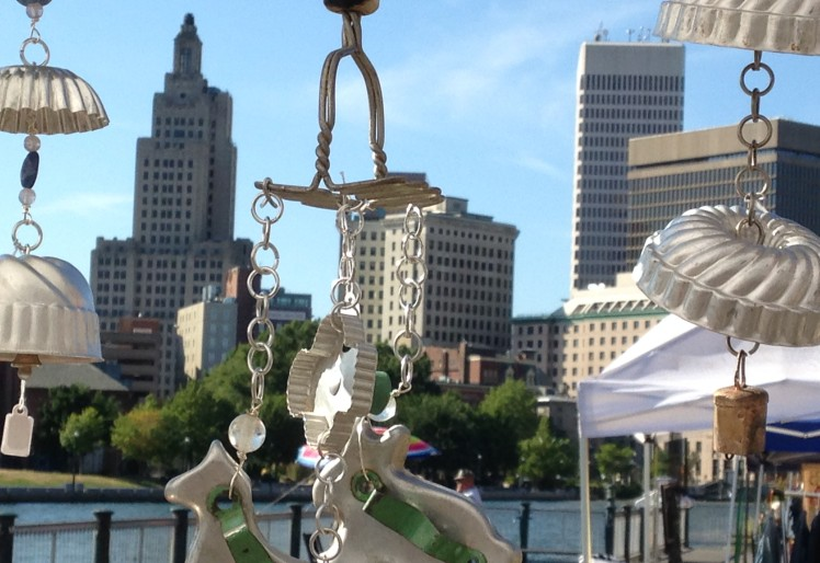 view of the city skyline through the kitchen kitsch mobiles and wind chimes